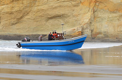 DSC_1654_the blue has landed (futzr.fotoz) Tags: pacificcity doryboat ocean blue orange sandstone cave breaker crashingwave landing sandbeach kiwanda rock