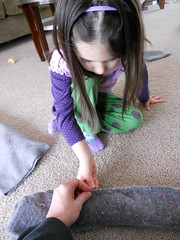 Peanut sews the rolled sweater