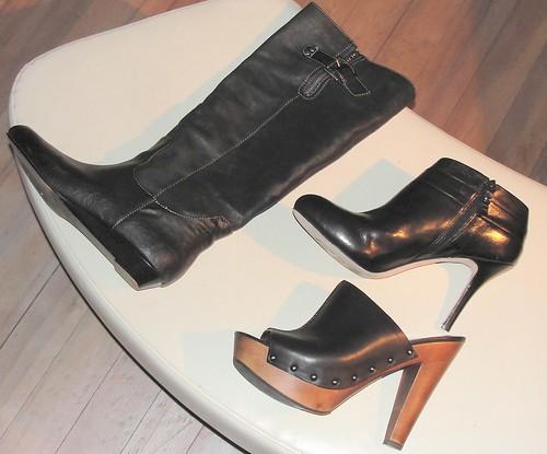 One black high boot, one black high heel ankle boot, one brown wood-soled platform clog