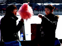 (zhengzhi) Tags: pink winter boy red love girl beijing young lovers eat cottoncandy share valentinesday candyfloss floss