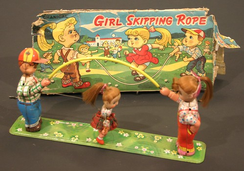 Girl Skipping Rope - a Japanese clockwork mechanical toy (est £25 to £35)