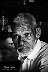 #Coorg, Karnataka [EXPLORE] March 2 2011 (Mayank Sharma renewed :D :D) Tags: street portrait bw india man face forest canon streetphotography oldman biscuit karnataka coorg strore