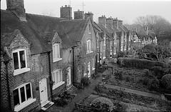 Historic houses (ammgramm) Tags: uk england blackandwhite bw house film 35mm blackwhite cheshire pentax terrace row historic spotmatic listedbuilding sandbach v700 v750