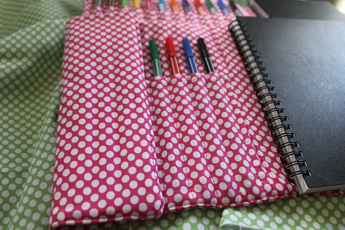 Notebook and pen roll holder half closed