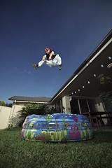Ninja Pete Enjoys a Swim (jæms) Tags: sky pool swim newcastle outside fly jump ninja australia pete float garder profoto remoteflash strobist