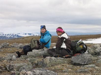 Elle Karen and Lajla Helene take a short break on Janssonhaugen.