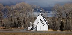 St. Theresa's Church (wyojones) Tags: storm church catholic cross wyoming np cottonwoods sttheresa meeteetse sttheresacatholicchurch wyomingskies wyojones