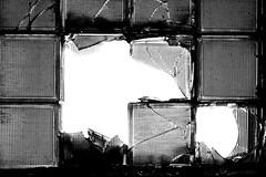 Broken blocks (Jochanas) Tags: bw cold brick abandoned broken window glass lines backlight grid blackwhite decay hard 7d shards