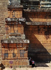 taking refuge from the sun (SM Tham) Tags: asia cambodia angkor unescoworldheritagesite prerup khmer stone temple architecture building tiers steps vendors shade shadows outdoors