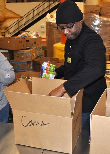 Southwest Region SNAP staffer Victor Hall boxes canned goods during a volunteer evolution at the North Texas Food Bank in Dallas. SWR SNAP program specialists choose a different partner Food Bank each quarter to assist in the war on hunger.