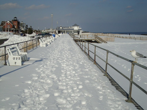Looking north on the Sea Girt boardwalk.  From left to right:  Sea Girt lighthouse, pavilion, and beach.