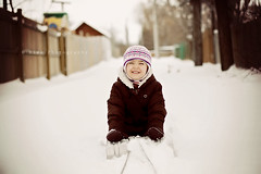 sleigh ride (creatively swinging) Tags: winter girl outdoors child 50mm14 sleigh snowbrown 5dmark2 riskphotography