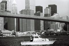 East River Cruise (Airicsson) Tags: street new york city nyc summer urban blackandwhite bw usa white ny black film rain vintage boat us minolta walk manhattan 101 rainy 2010 streetshot srt