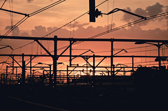 Power (Zeromusta) Tags: city sunset red sky orange sun black station yellow train afternoon power horizon low sydney platform peach rail trains overhead redfern cityrail dailyshoot ds445