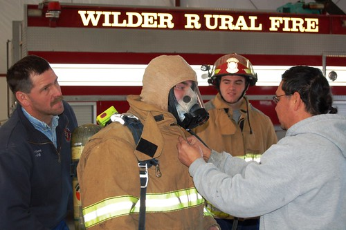 Wilder Volunteer Fire Fighters educate Job Corp Students on protective gear during Groundhog Job Shadow Day.  (L to R)Craig Lane, firefighter; John Gillette, student; Chris Henning, student; and De Enrico, firefighter.