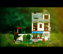 Lazy Sunday (isayx3) Tags: house umbrella toy pull nikon shoot dof lego bokeh bbq push shallow studios f28 43 80200mm thru onelight sb800 strobist plainjoe isayx3 plainjoephotoblogcom