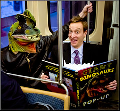 Wow! What Are the Chances? (TheeErin) Tags: friends chicago window train reading book illinois comedy cta mask duo authority ken el il suit transit rails barnard comedian l popup spencer dudes langley dinosaurs brownline velociraptor chicagoland chicagotransitauthority chicagoist kenbarnard ridership masstrans velocoraptor recomedymagazine spencerlangley