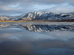 Sulfell (h) Tags: blue winter sky mountain lake snow reflection ice clouds landscape iceland patterns february stillness vatn hvalfjrur speglun svnadalur eyrarvatn sulfell