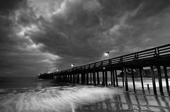 The Dark Side of the Wharf - Capitola, California (Jim Patterson Photography) Tags: ocean california morning sky blackandwhite usa santacruz seascape storm beach nature monochrome clouds contrast dark landscape dawn coast pier pacific ominous dramatic montereybay stormy coastal wharf coastline drama capitola jimpattersonphotography jimpattersonphotographycom seatosummitworkshops seatosummitworkshopscom