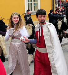 How *dare* you steal a glance at my girl? (Jumpin'Jack) Tags: carnival boy white black tiara girl bells children cow costume long princess beards prince parade gloves faced cape spectators murky dwarves observers frowning clad ptuj shrovetide jpingjk