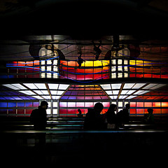 life at the airport (barbera*) Tags: people chicago wall reflections airport colours silhouettes pedestriantunnel chicagoohare barbera movingwalkway 3620c