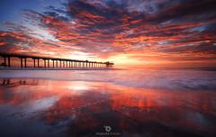 Nostalgia! (Mohanram Sathyanarayanan) Tags: fire sunset water beach travel night sun light clouds ocean waves glow fall california pier sand seascape longexposure sandiego fiery lajolla scrippspier