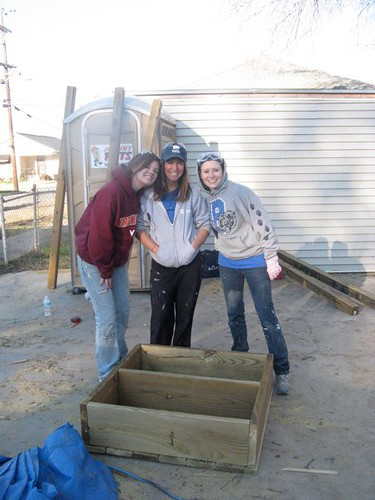 Kelly Mix and Katie Powell (Class of 2011) with Habitat for Humanity leader, Jesse (center)