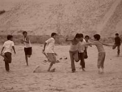 Young boys playing in the desert (amazing_tina) Tags: india playing silly boys fun sand desert indian clothes basic rajasthan gmaes schoolboys
