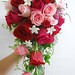 Cascade style- Red and pink roses, stephanotis