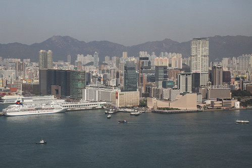 Tsim Sha Tsui, Kowloon, and Lion Rock in the background