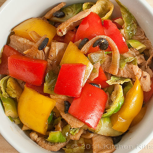 Bowl of Pork, Peppers, Brussels Sprouts, and Black Bean Stir-Fry