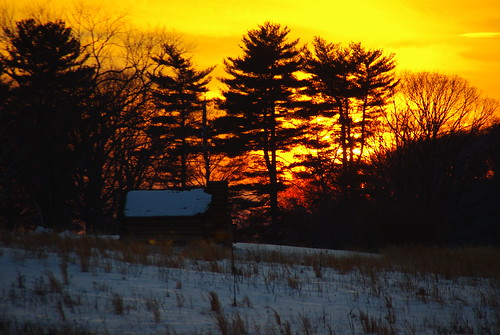 A winter's sunset over a cabin at Valley Forge