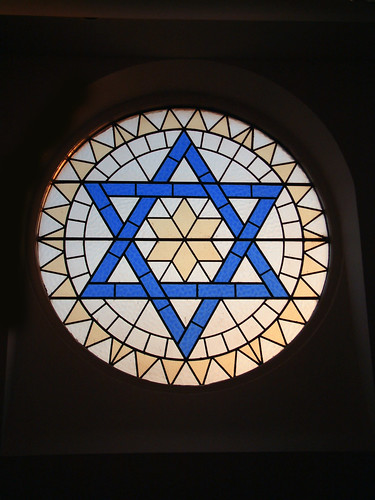 Star of David in the stained glass windows of a temple