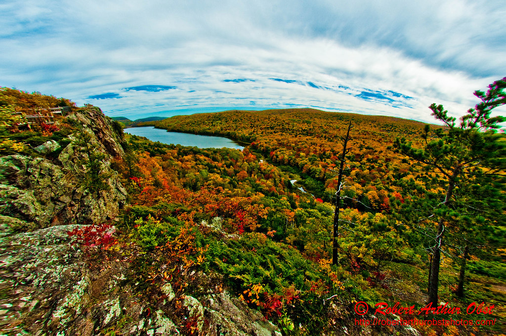 The Wilderness Society Wild Adventures Photo Contest - Escarpment Trail hikers' view of autumn foliage framing Lake of the Clouds and the Lower Carp River within Porcupine Mountains Wilderness State P