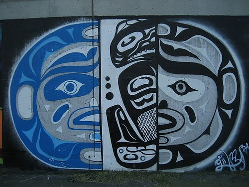 indigenous graffiti showing the sun, the moon and a fish in Vancouver