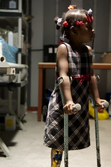 Trying out her new prosthesis (JP Theberge) Tags: haiti amputees challengedathletes