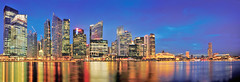 Singapore Skyline Panorama (williamcho) Tags: city panorama reflection tourism architecture singapore ngc financialdistrict bluehour attraction centralbusinessdistrict blending d300 mbfc flickrestrellas williamcho marinabayfinancialcentre