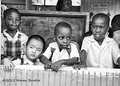 What Did You Learn At School Today? (Karen Brodie Photography) Tags: school boy portrait people bw woman girl monochrome kids children nikon child candid nursery teacher uniforms blackboard tobago masonhall d700 dsc6097