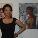 Tatyana in front her artwork