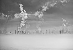 Apocalyptic (Bruce Bordelon) Tags: white plant black industry monochrome fog sunrise silver river mississippi lens rouge dawn nikon louisiana industrial conversion zoom smoke foggy burn pollution pro nikkor refinery f28 baton chemical stacks exxon 80200mm efex d700