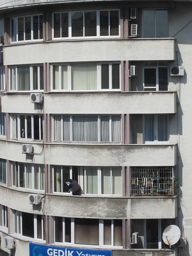 Izmiri Woman cleaning her windows.