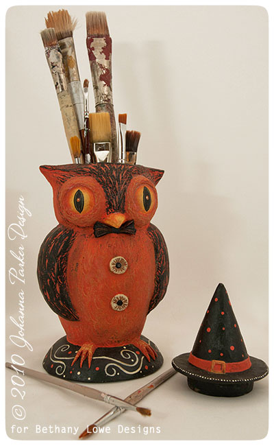 Sweet-Owlfred-holds-paintbrushes