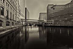 Water Under the Bridges (CJ Schmit) Tags: monochrome sepia canon downtown bridges milwaukee toned milwaukeeriver goldsgym canonef1740mmf40lusm pbcs 5dmarkii canon5dmarkii cjschmit wwwcjschmitcom photographybycjschmit wisconsinurban