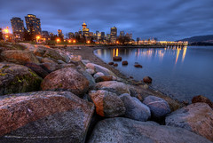 Vancouver on the Rocks (Brandon Godfrey) Tags: city urban beach water skyline night vancouver clouds buildings reflections landscape photography twilight scenery rocks bc photos pics britishcolumbia scenic pacificnorthwest bluehour gastown canadaplace coalharbour harbourcentre crabpark portsidepark