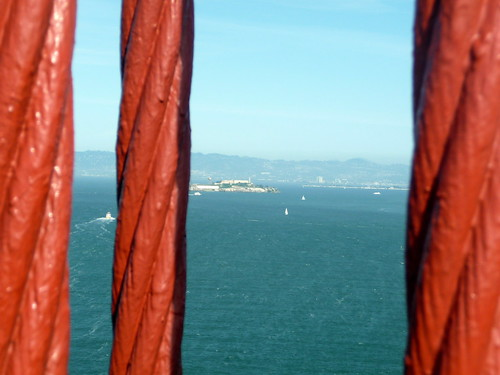 Alcatraz Island viewed from red Golden Gate Bridge cables, San Francisco, California, Western United States of America