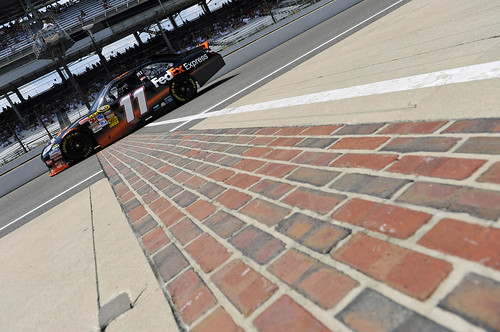 Denny Hamlin's #11 FedEx car crosses the yard of bricks in 2010