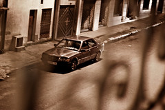 Moroccan Wheels (Geraint Rowland Photography) Tags: old window car sepia automobile framed wheels morocco kenitra