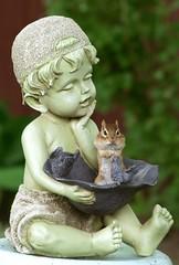 One Laid Back Dude (SavingMemories) Tags: boy cute statue fur mouse rodent hands squirrel critter chipmunk cheeks paws chippy chubbycheeks supershot savingmemories onelaidbackdude suemoffett