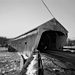 Walk Your Horse Or Pay Two Dollar Fine, Woodstock, Vermont (Gerald L. Campbell) Tags: bridge blackandwhite bw rural blackwhite vermont coveredbridge woodstock plusx 500x500 olympusom2n ruralscene scenicphotography 28mmzuikolens 4tografie minoltamultiproscanner
