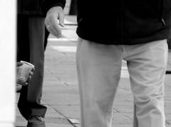 Una limosna/An Alms (Joe Lomas) Tags: poverty madrid street leica urban blackandwhite bw espaa byn blancoynegro calle spain candid poor bn beggar reality streetphoto urbano pobre indigente mendigo pobreza indigencia urbanphoto realidad limosna robados realphoto necesitado pordiosero limosnero fotourbana fotoenlacalle fotoreal photostakenwithaleica